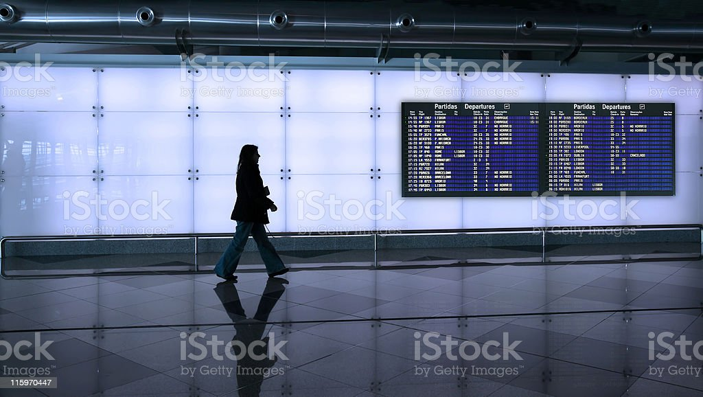 woman walking in the airport royalty-free stock photo