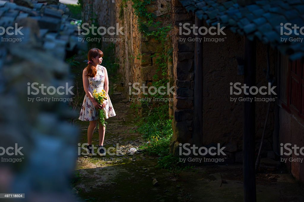 Woman walking in the Chinese countryside stock photo