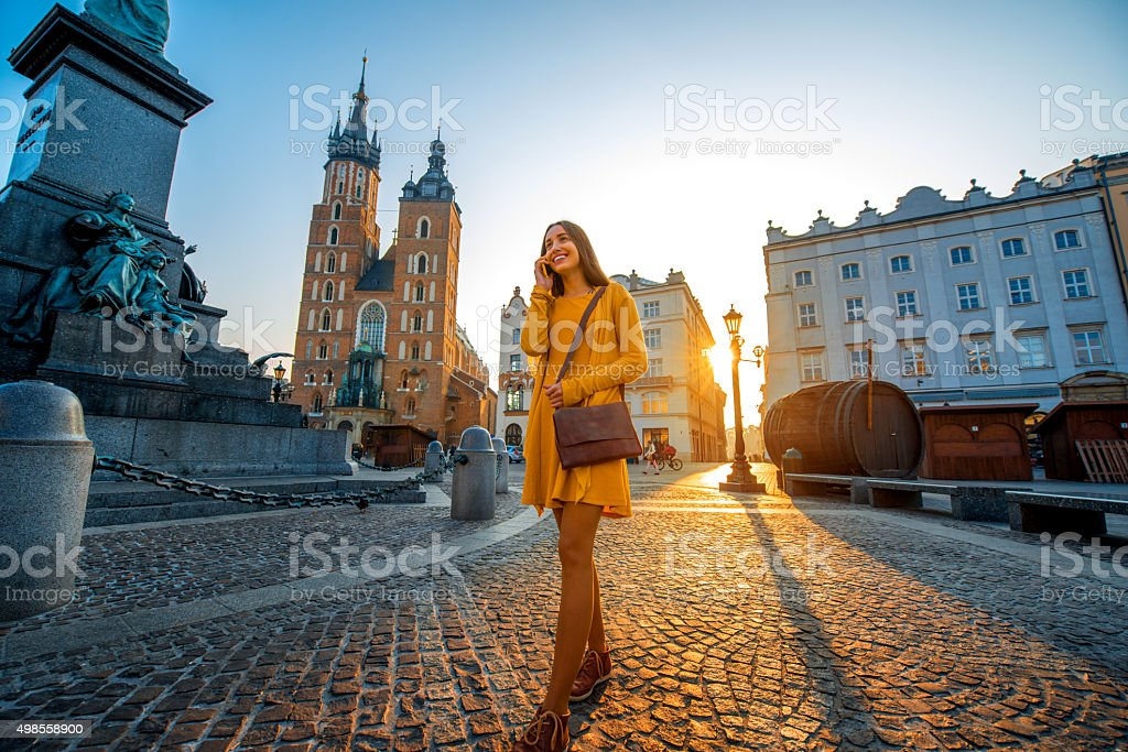 Woman walking in the old city center of Krakow stock photo