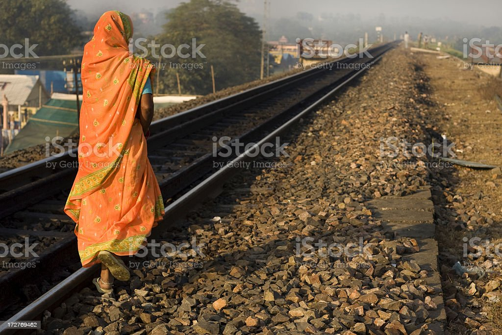 woman walking in the railroad royalty-free stock photo