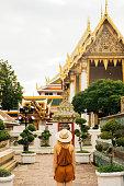Woman walking in Wat Pho temple