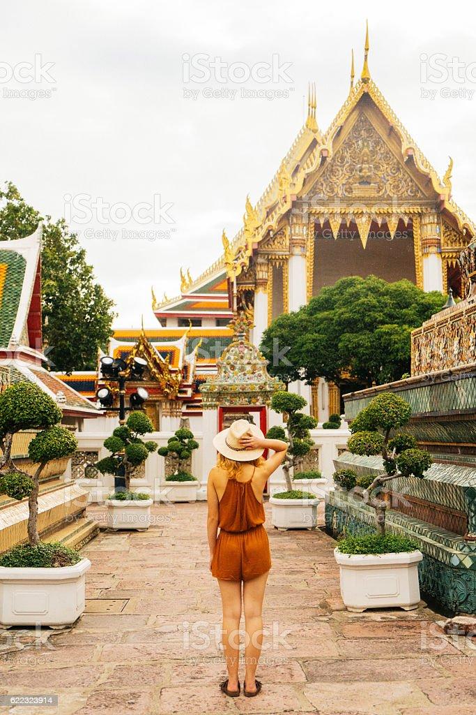 Woman walking in Wat Pho temple stock photo