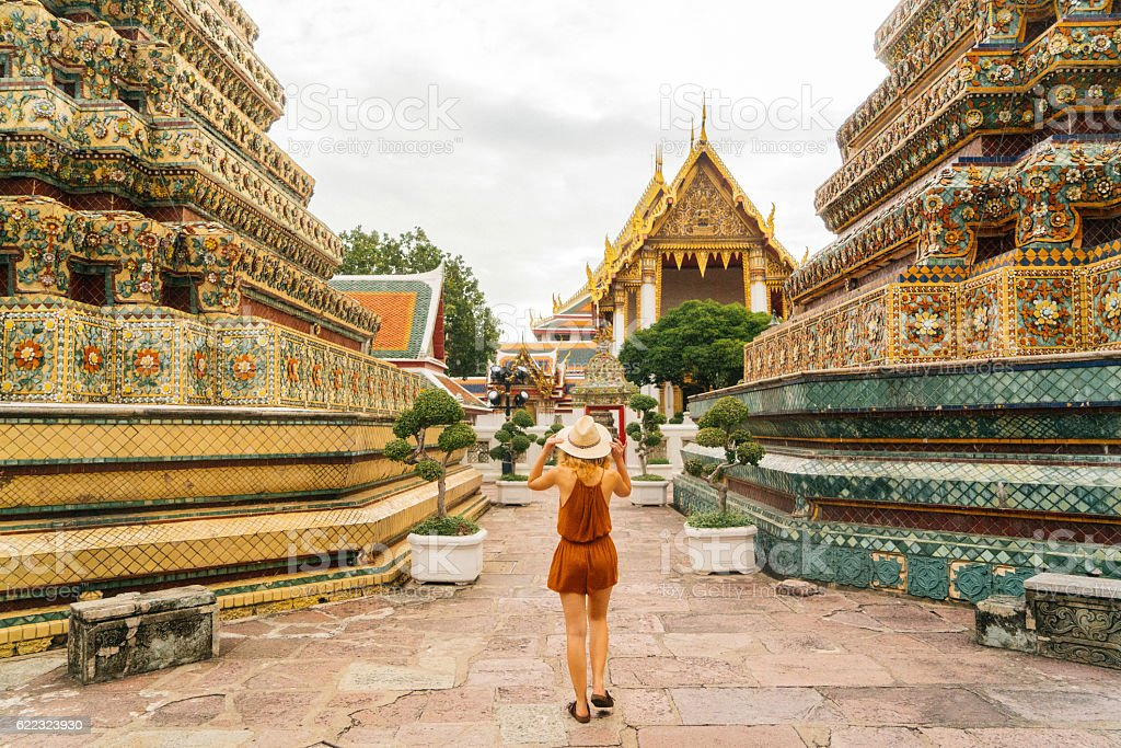Woman walking in Wat Pho temple stock photo