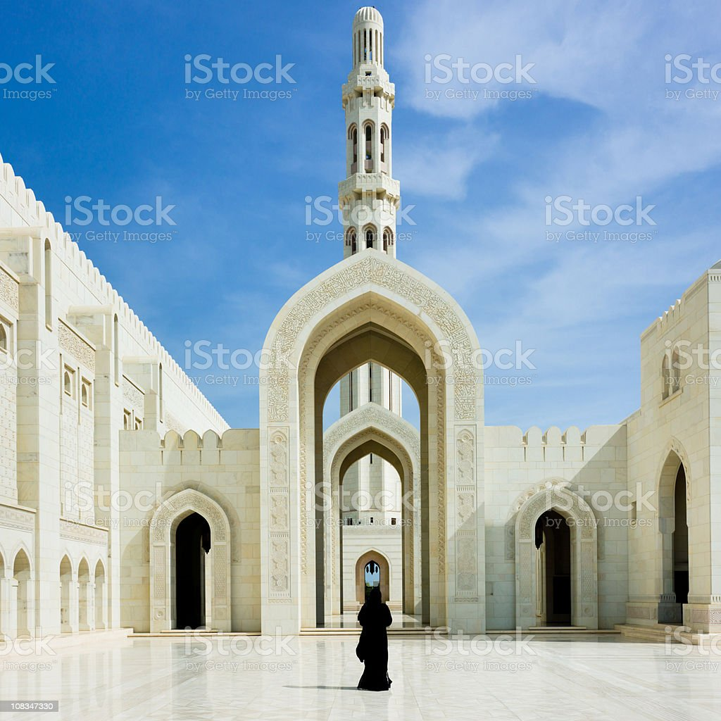 Woman walking inside Sultan Qaboos Grand Mosque Muscat Oman stock photo
