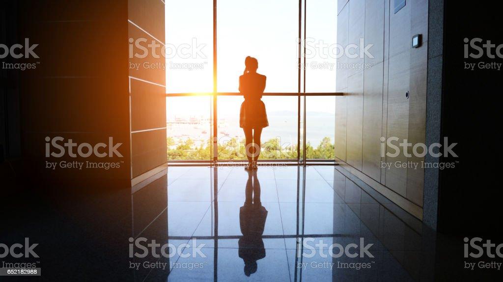 woman walking into the light stock photo