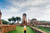 Woman walking near  ancient Buddhist Temple