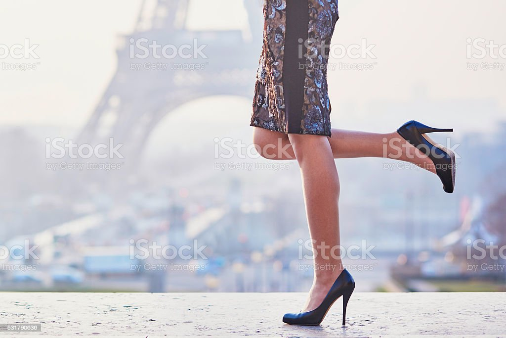 Woman walking near the Eiffel tower stock photo
