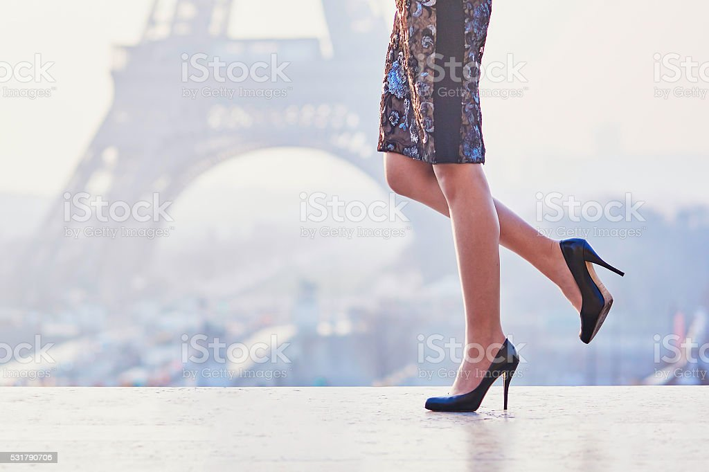 Woman walking near the Eiffel tower stock photo