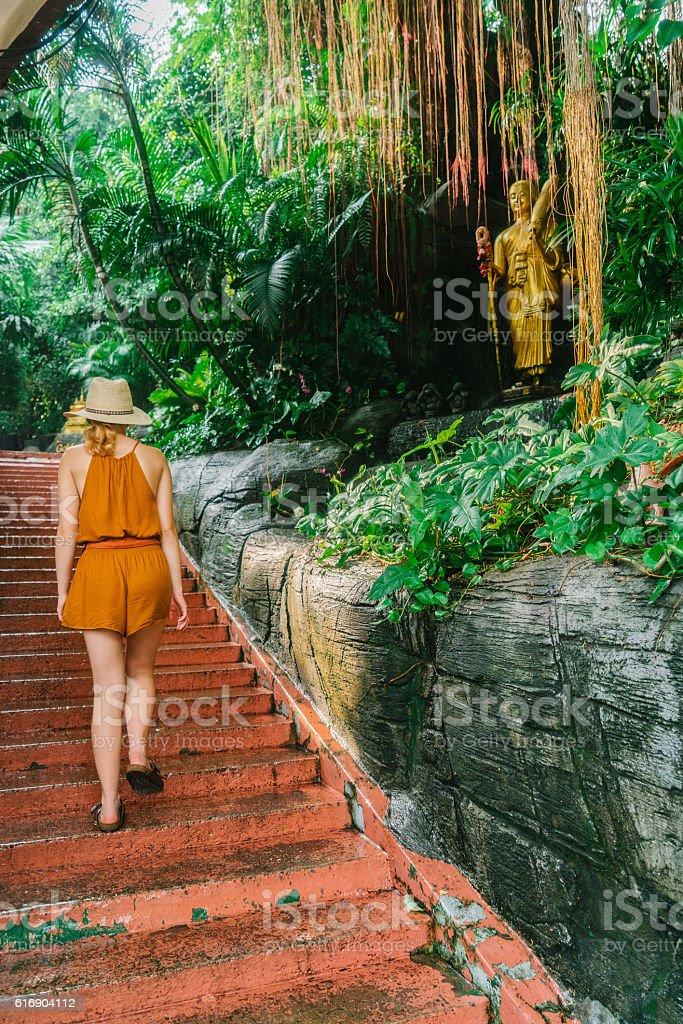 Woman walking near the Golden Mount in Bangkok stock photo