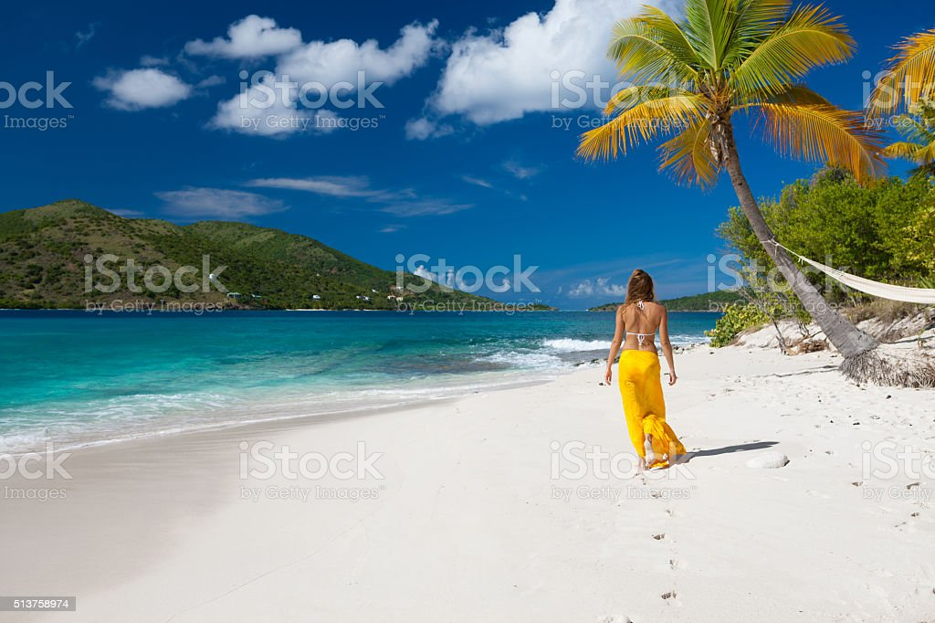 woman walking on a deserted island stock photo