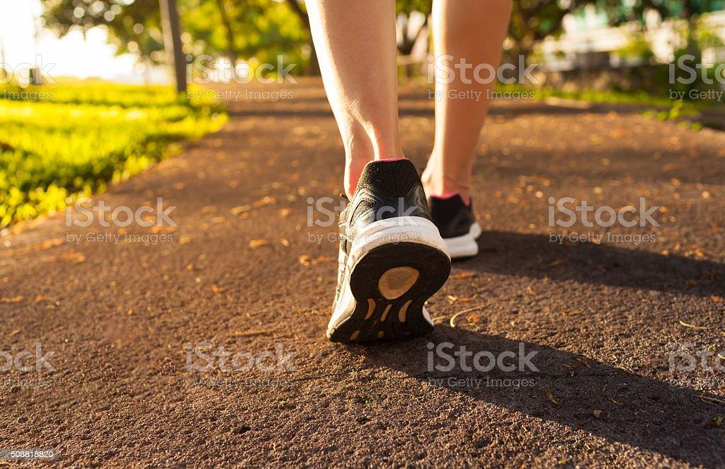 Woman walking on a path stock photo