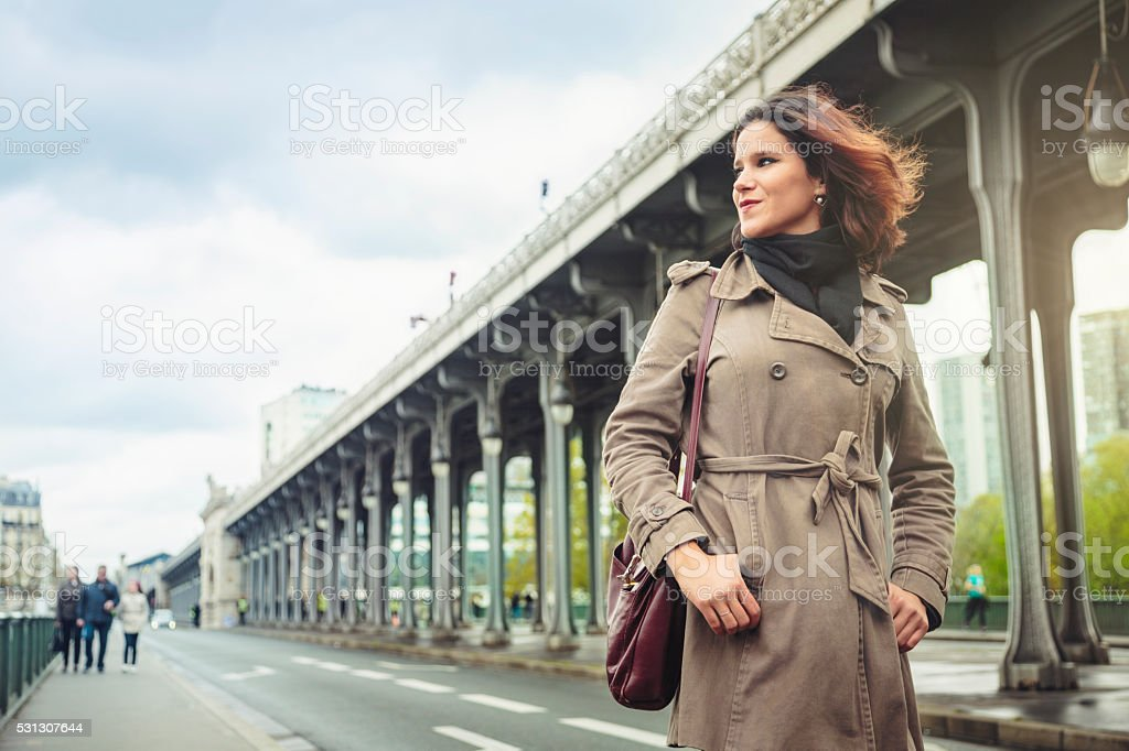 Woman walking on Bir-Hakeim bridge in Paris. stock photo