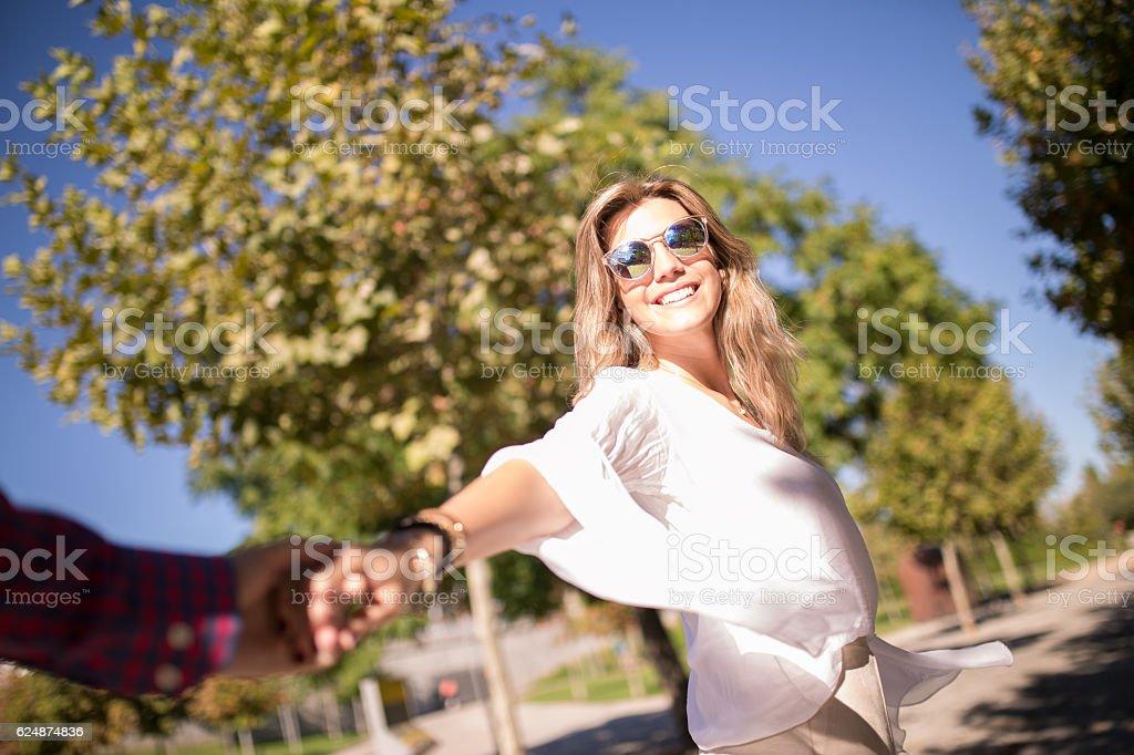 Woman walking on romantic honeymoon and holidays holding hand stock photo
