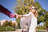 Woman walking on romantic honeymoon and holidays holding hand