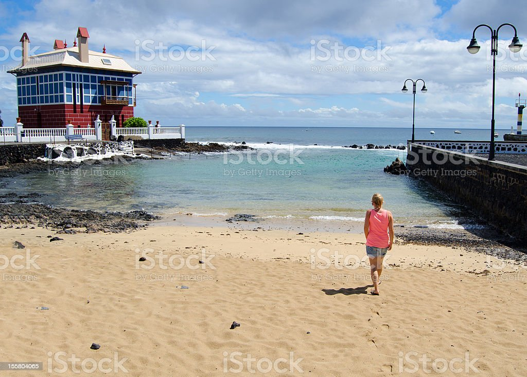 Woman walking on the beach of Arrieta royalty-free stock photo