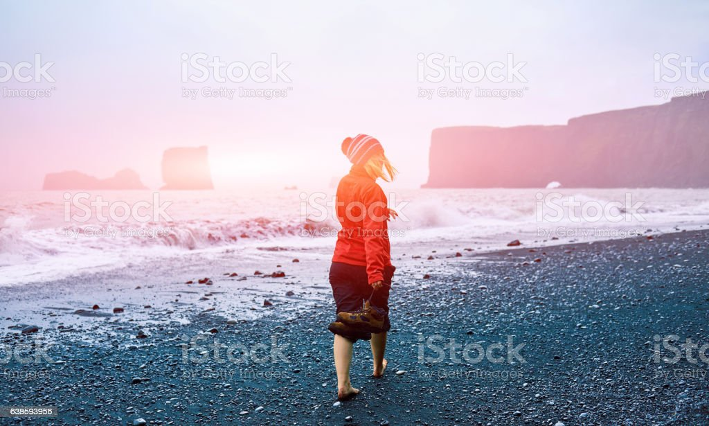 woman walking on the beach stock photo