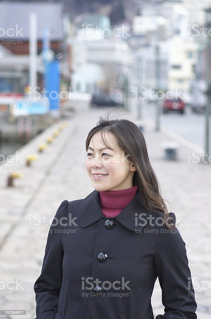 Woman walking on the city street royalty-free stock photo