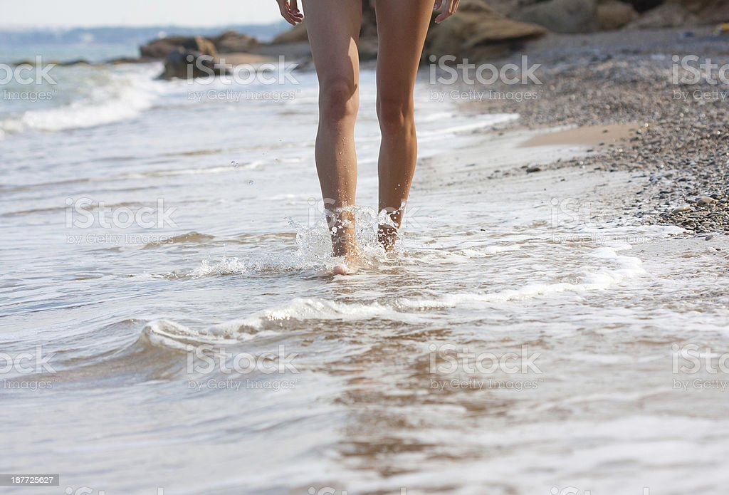 woman walking on the sand beach royalty-free stock photo