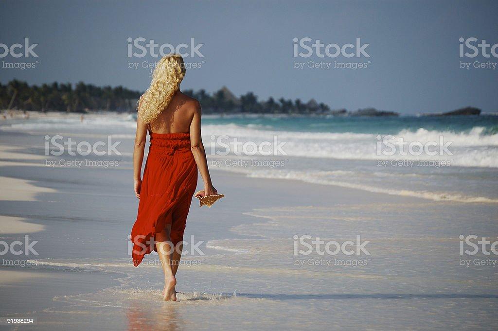 Woman walking on tropical beach royalty-free stock photo