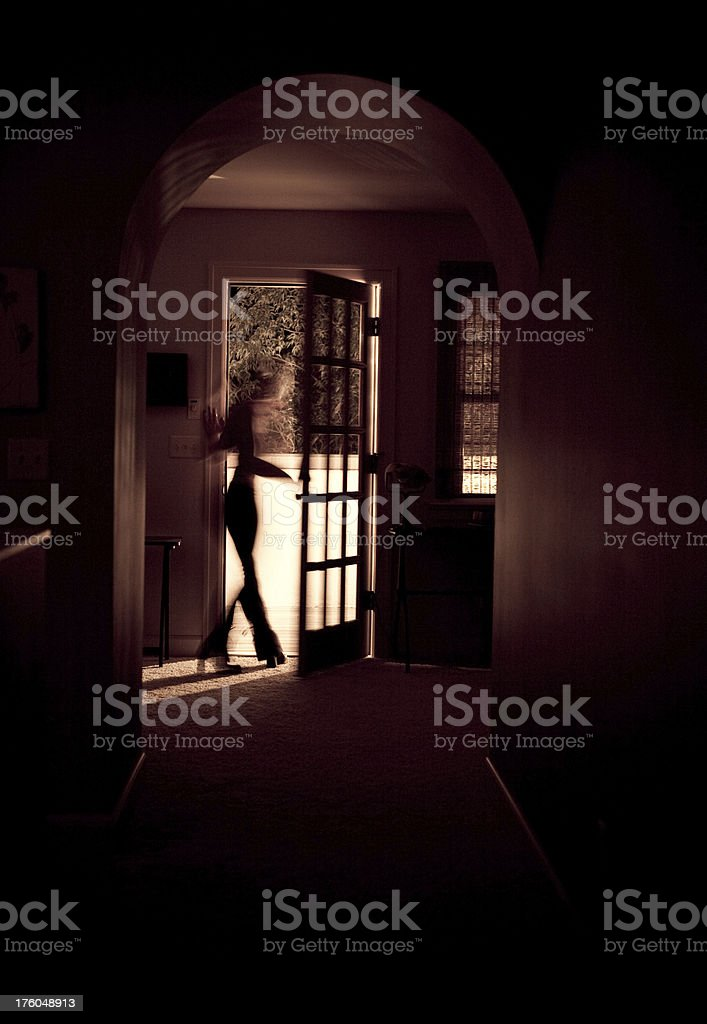 Woman walking out the backdoor royalty-free stock photo