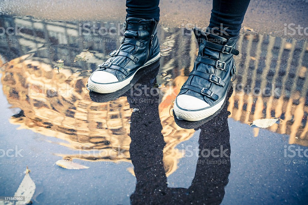 Woman walking outdoor after a rainfall royalty-free stock photo