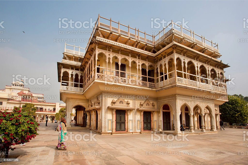 Woman walking past fantastic building in Rajasthan stock photo
