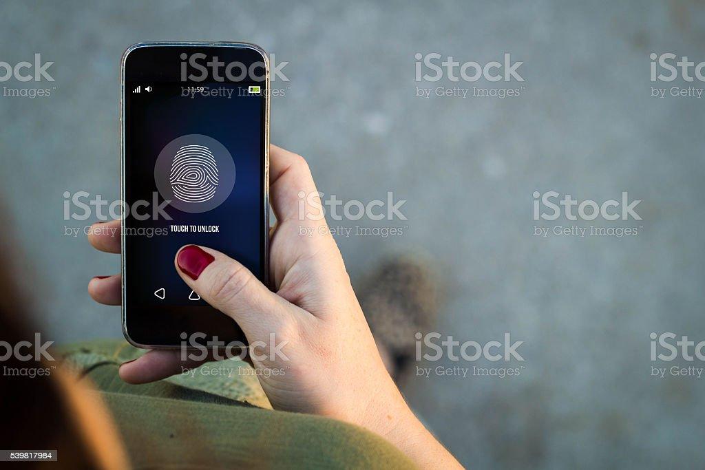 Woman walking smartphone fingerprint stock photo