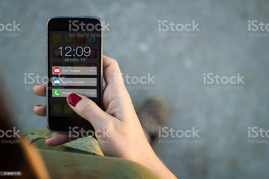 Woman walking smartphone notifications stock photo