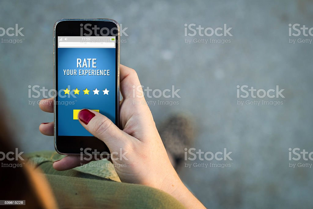 Woman walking smartphone rating on a web stock photo