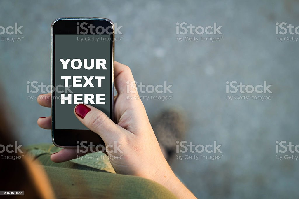Woman walking smartphone your text here stock photo