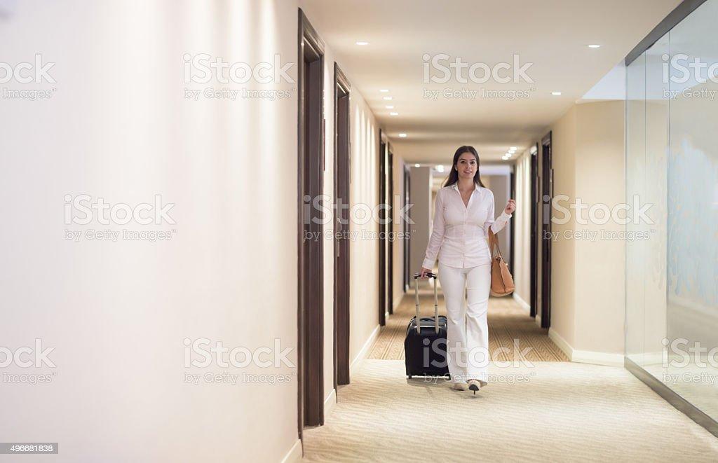 Woman walking through a hotel stock photo