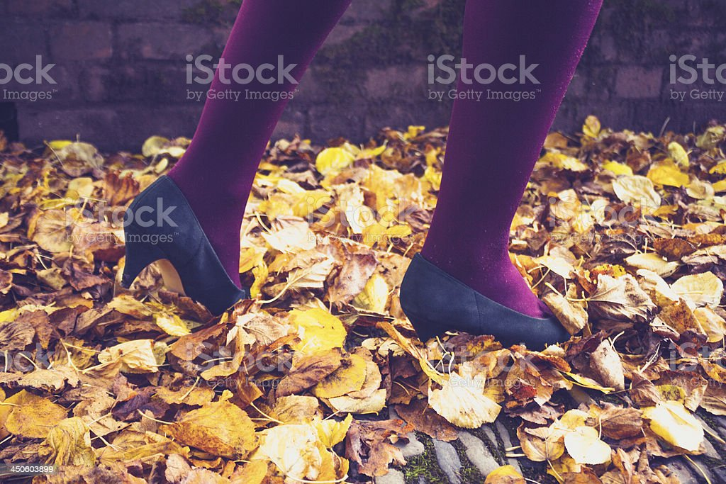 Woman walking through leaves royalty-free stock photo