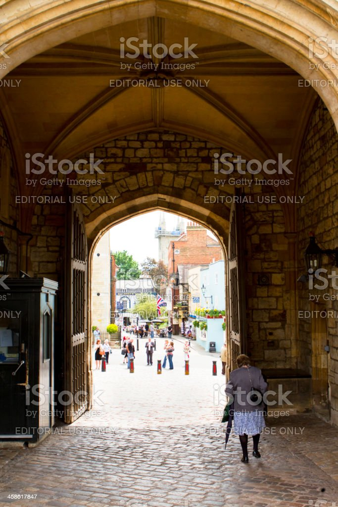 Woman Walking Through The Arch Of Windsor Castle stock photo