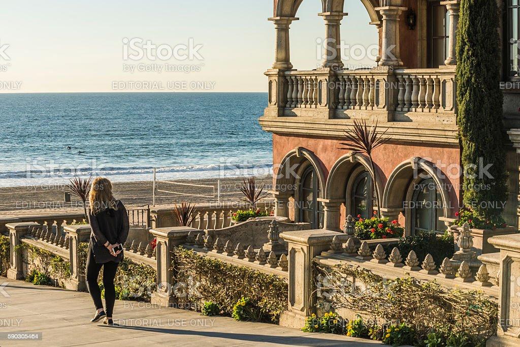 Woman walking to beach boardwalk in Los Angeles stock photo