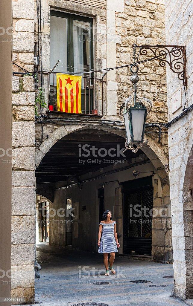 Woman walking under a Estelada flag in Girona. Spain stock photo