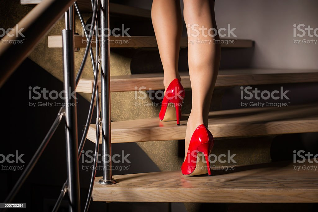 Woman walking up stairs stock photo