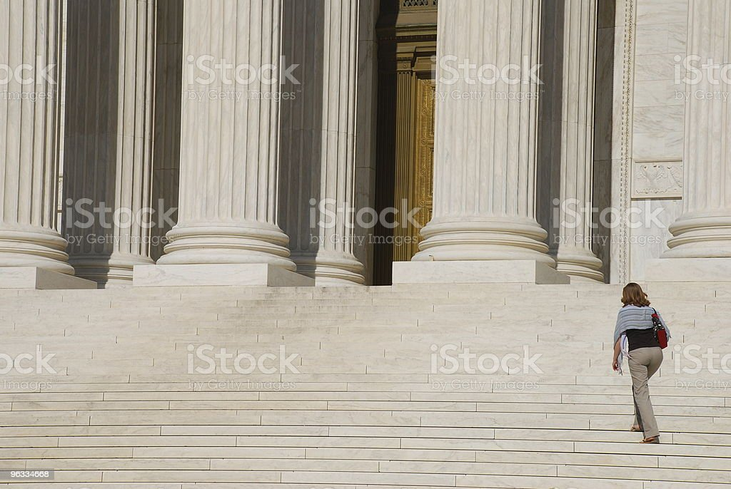 Woman walking up Steps of US Supreme Court stock photo