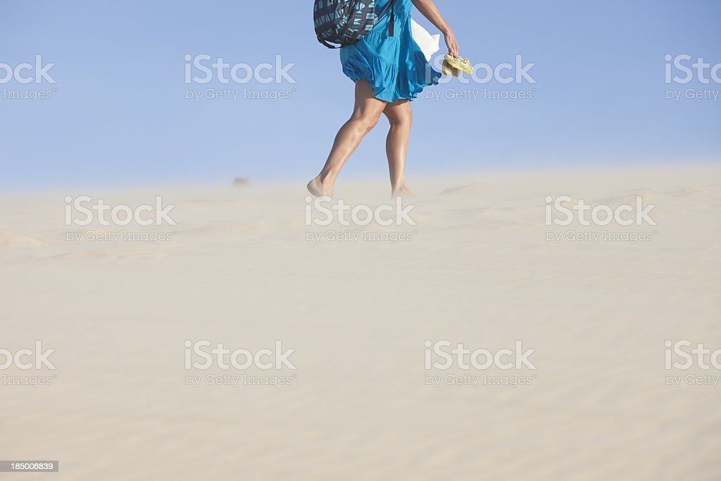 Woman walking up to the Sand Dune stock photo