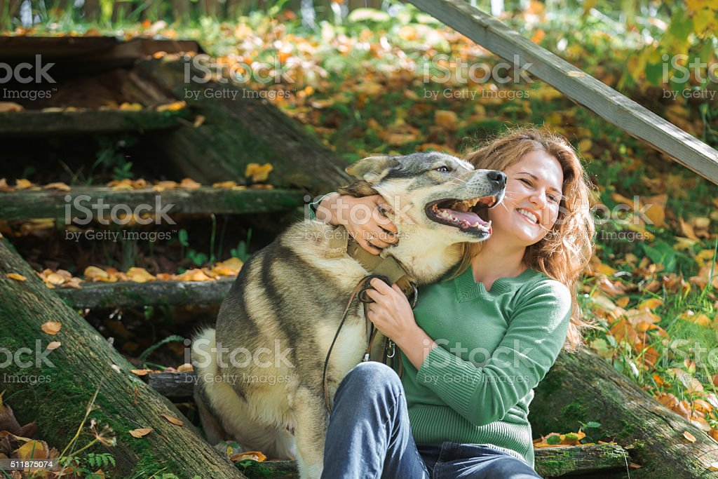 Woman  walking with a hunting dog. stock photo