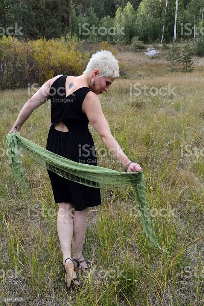 Woman Walking with a Scarf royalty-free stock photo