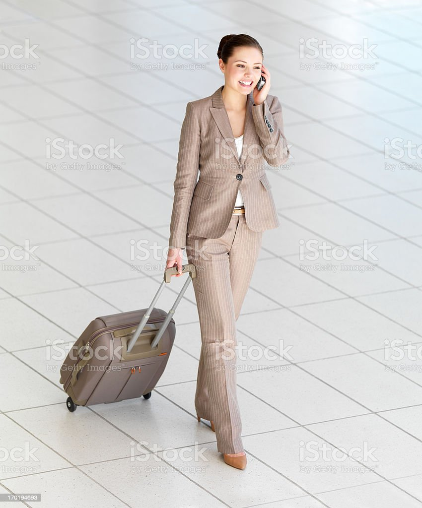 Woman walking with luggage at the airport. royalty-free stock photo