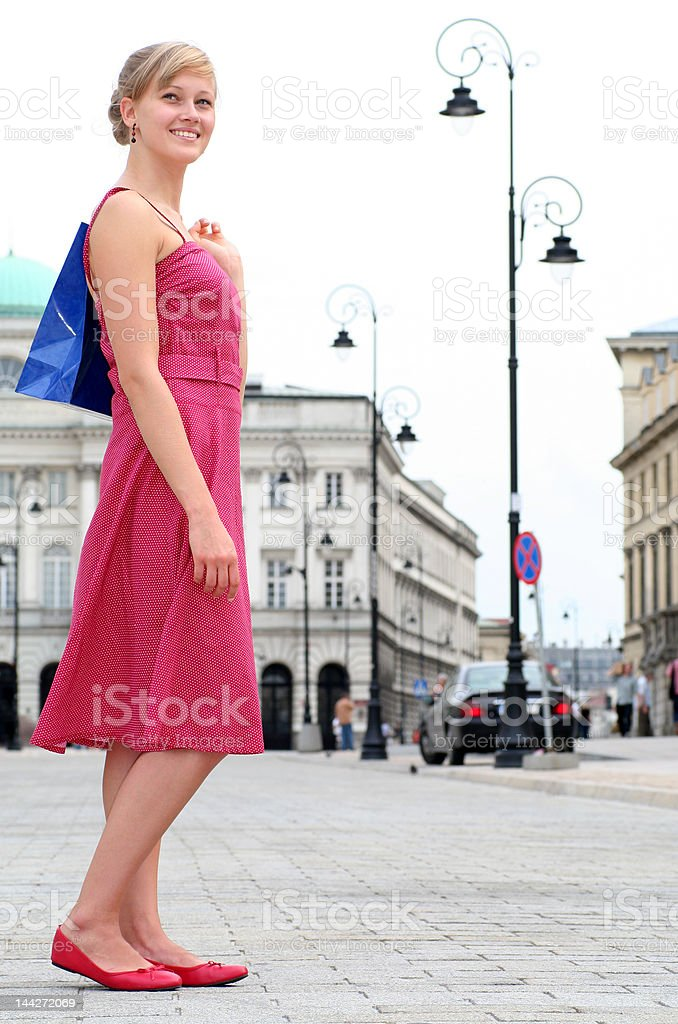 Woman walking with shopping bags royalty-free stock photo