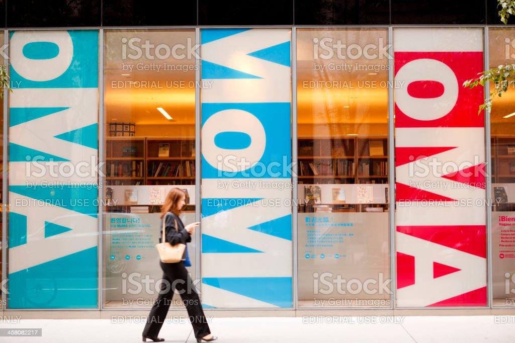 Woman Walks by Museum of Modern Art Store Manhattan stock photo