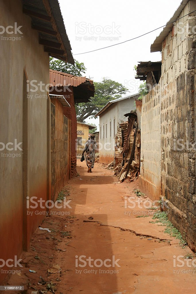 woman walks in african town royalty-free stock photo