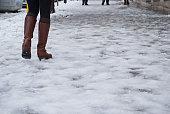 Woman walks on icy street