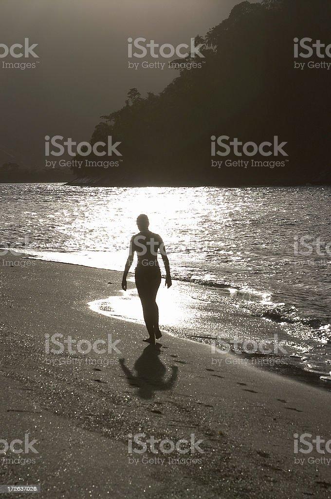 Woman walk's on the beach royalty-free stock photo