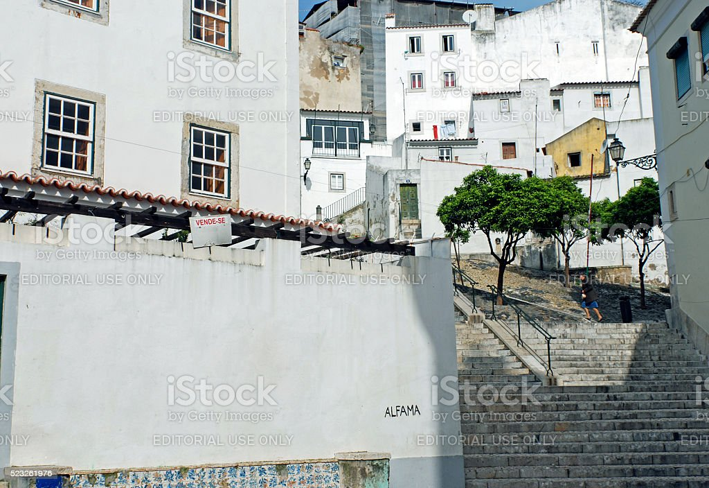 Woman walks up stairs in Alfama district of Lisbon Portugal stock photo