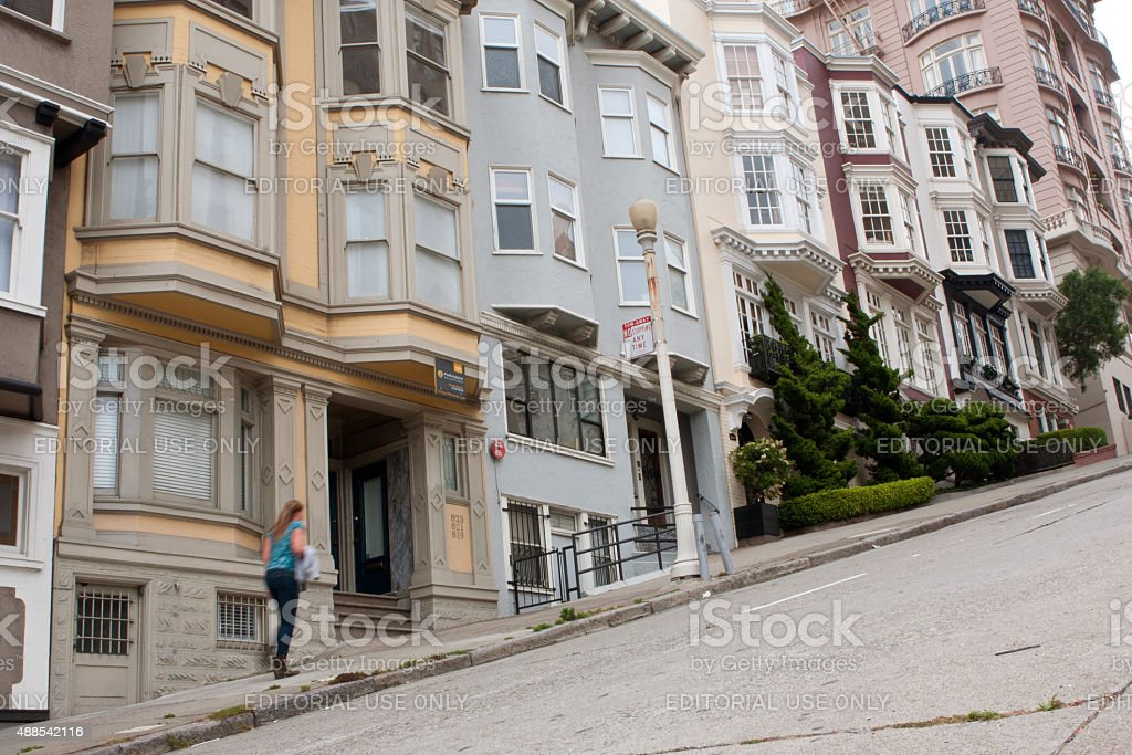 Woman Walks Up Steep Incline On Nob Hill Street stock photo