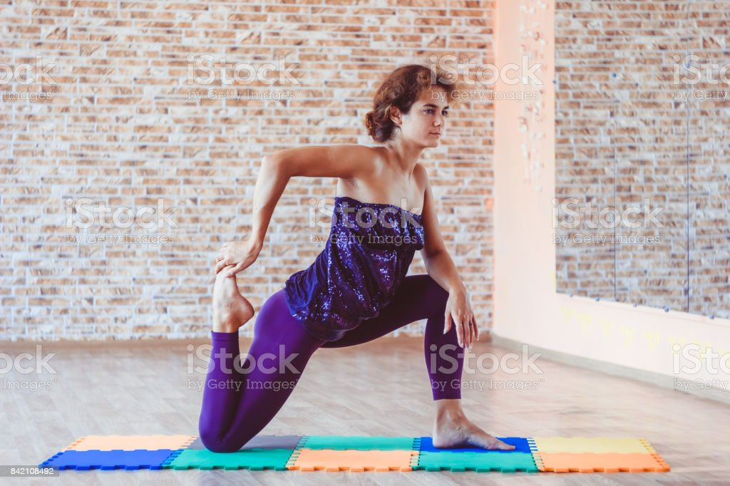 A woman warmes up in the hall stock photo