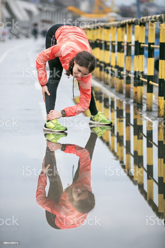 Woman warming up before going for a run stock photo